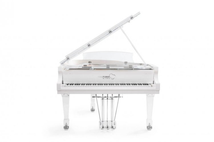 Aire acrylic piano with chrome trim