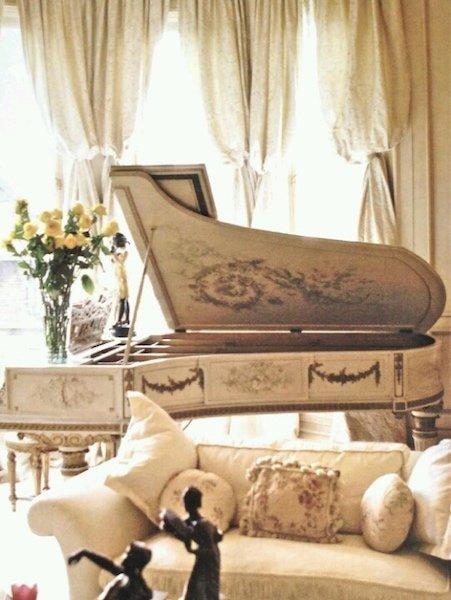 Baroque style white grand piano