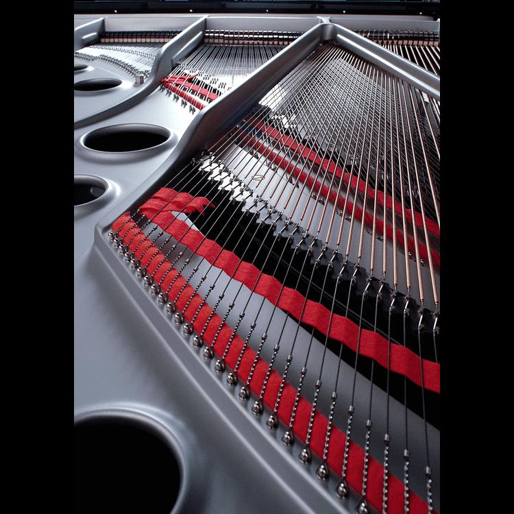 chrome plate inside a grand piano