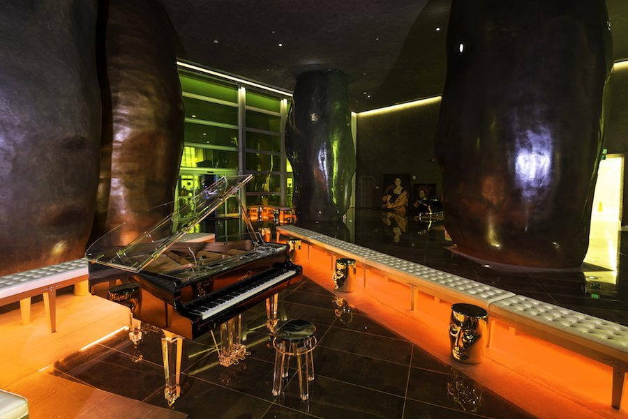 Aire semi-transparent baby grand piano at Brickell