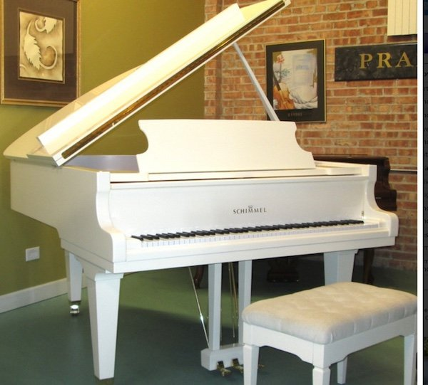 white Schimmel baby grand piano