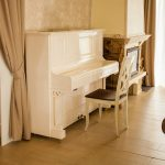 old white upright piano