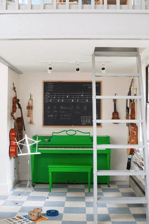 green upright piano by the wall