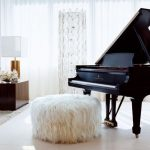 wooly ottoman next to a piano