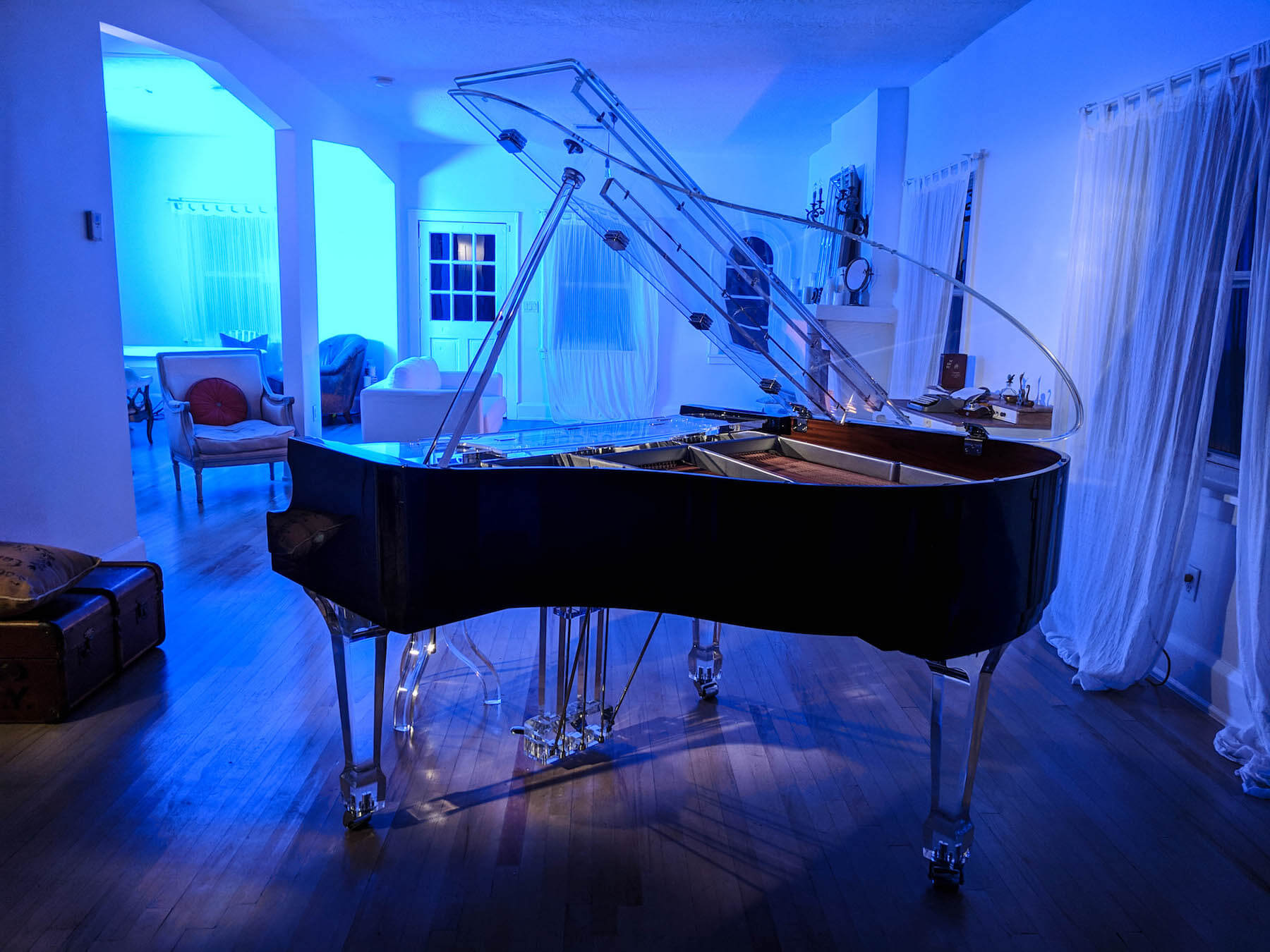 Side view of acrylic baby grand showing standard piano width