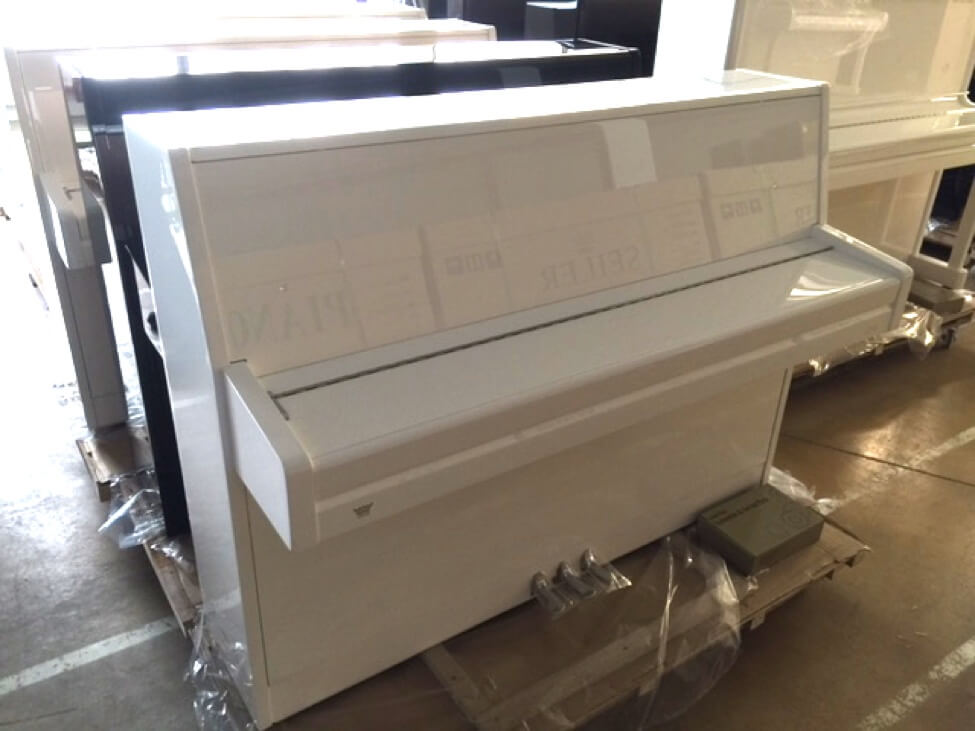 white upright piano