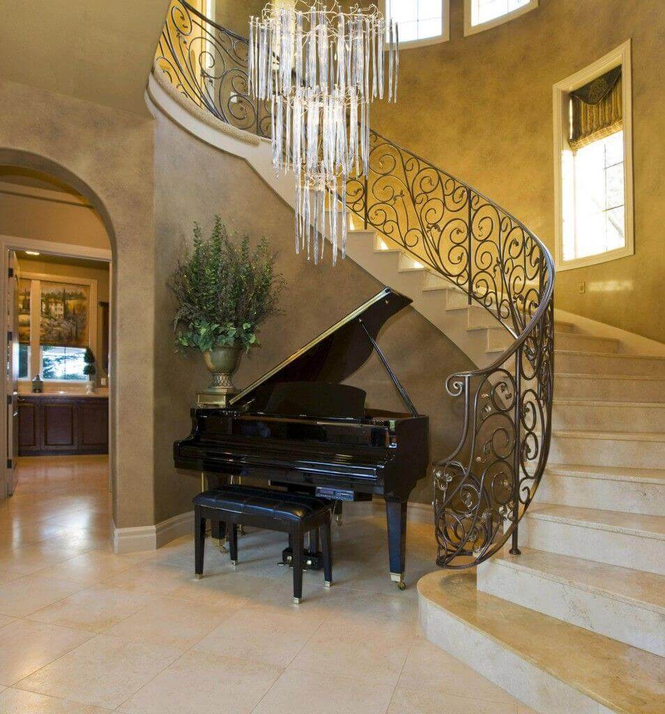 grand piano by the staircase