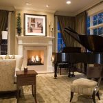 living room with a grand piano in a corner