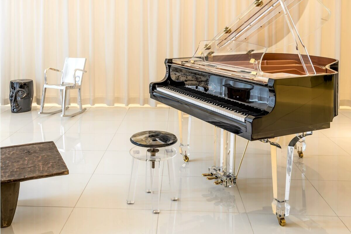 Aire Acrylic Baby Grand Piano in black trim