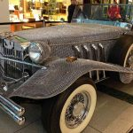 vintage Duesenberg roadster covered in crystals