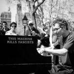 Colin Huggins plays at Washington Square