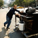 Rolling an upright piano on the streets of New York
